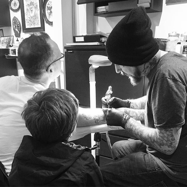 Normally we don't let kids come back into the studio but this young man designed his Dad's tattoo so we let the artist watch his drawing become a tattoo. ❤️ #welovetattooingyou