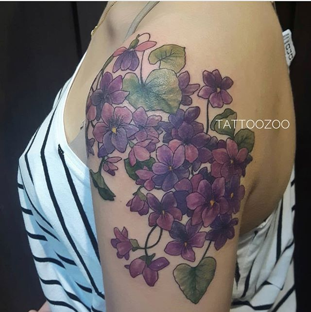 Beautiful violets by @marymadsentattoos Call 250-361-1952 to book your free consultation. #weLOVEtattooingyou