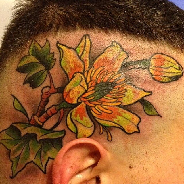 mason flower head tattoo
