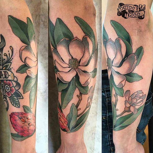 Beautiful magnolia by @davidmaiertattoos Call 250-361-1952 to book.